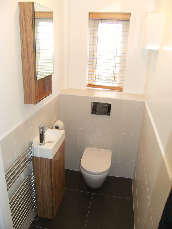 Bathrooms by complete concept plumbing tiling for Toilet room decor